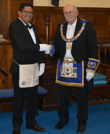 Bro. Ramos being congratulated by VWBro. Ian R. Berry, Worshipful Master